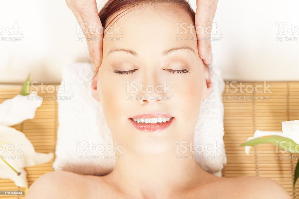 Beautiful girl receiving head massage in a beauty salon royalty-free stock photo