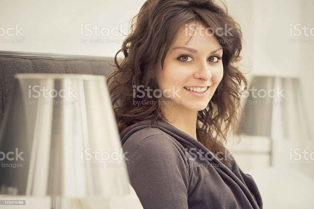 Beautiful girl relaxes in the bedroom portrait stock photo