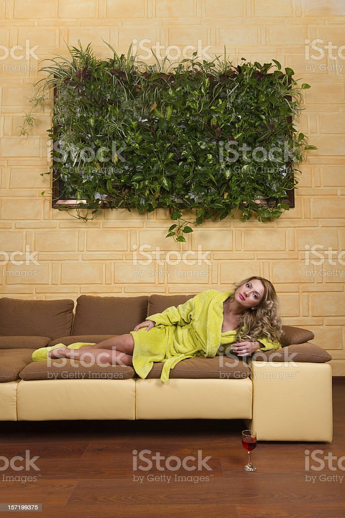 Beautiful Girl Relaxes On The Couch royalty-free stock photo