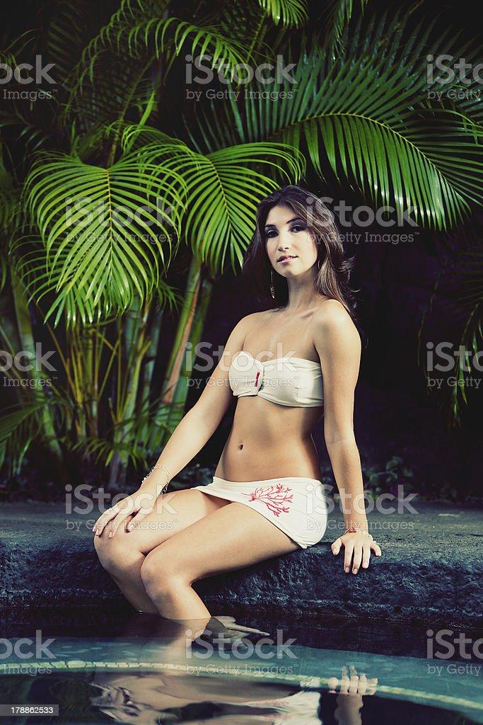 Beautiful Girl Relaxing at Tropical Resort stock photo