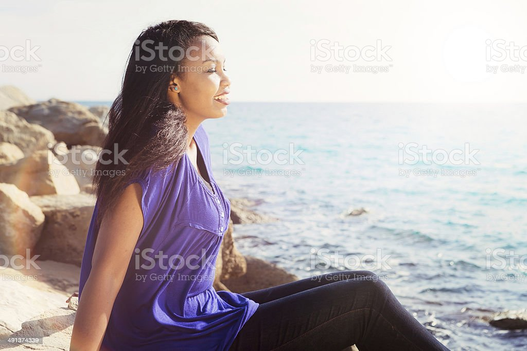 Beautiful Girl Relaxing By the Sea royalty-free stock photo