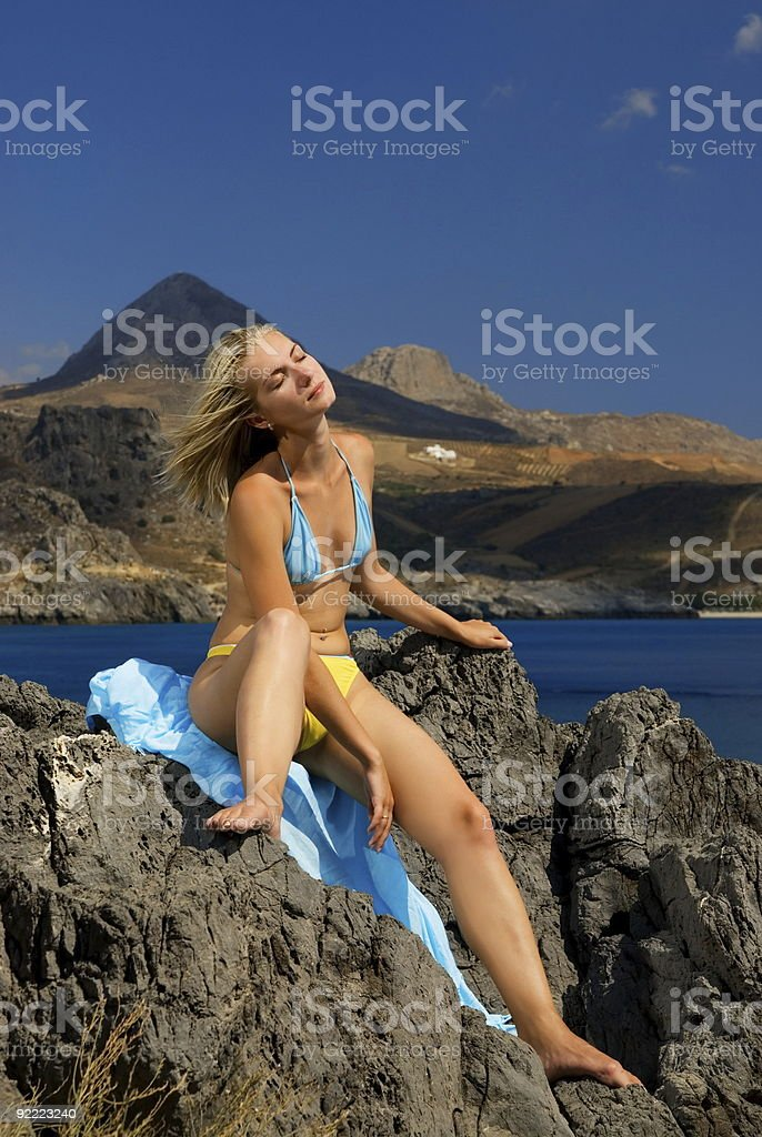 Beautiful girl relaxing near the sea royalty-free stock photo