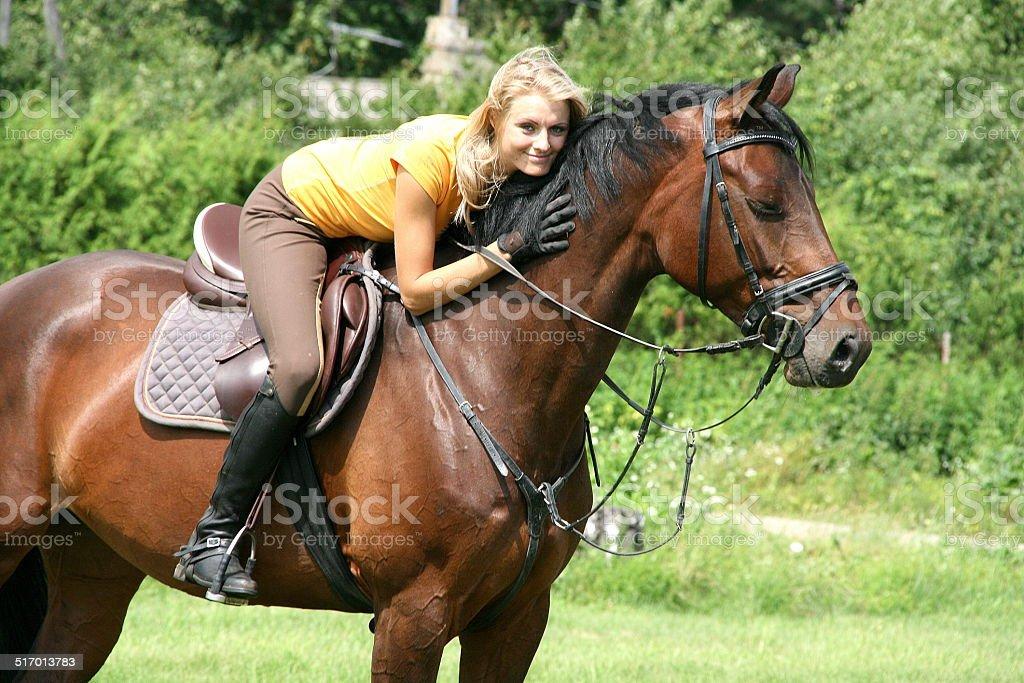 Beautiful girl riding a horse stock photo