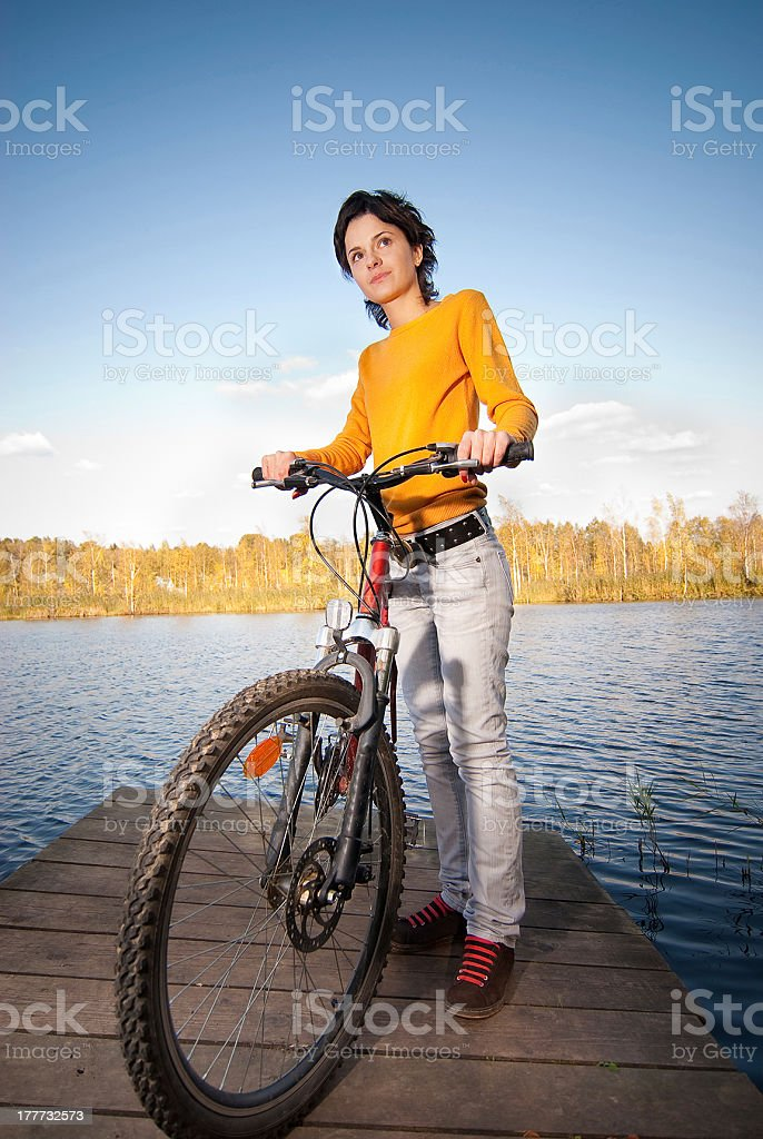Beautiful girl riding bicycle royalty-free stock photo