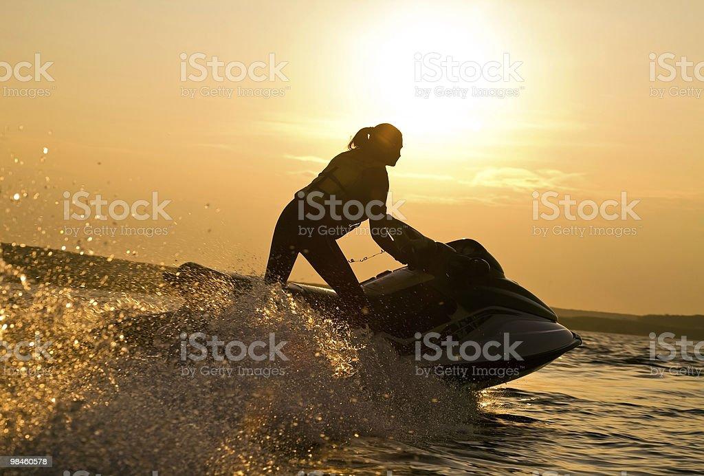 beautiful girl riding her jet skis stock photo