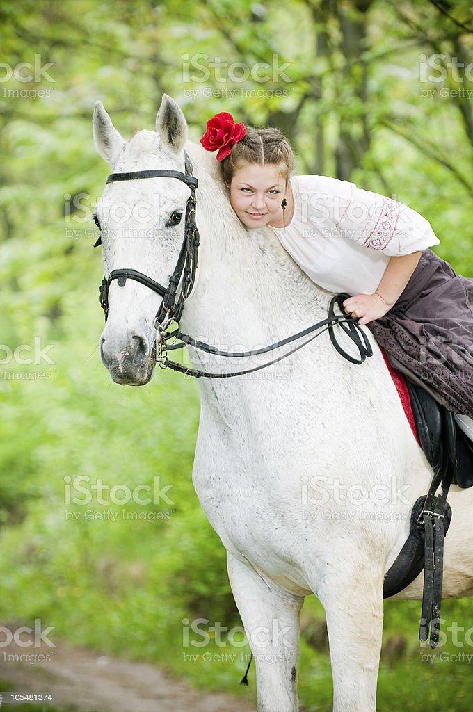 Beautiful girl riding white horse royalty-free stock photo