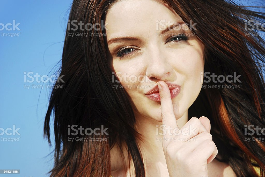 Beautiful girl saying shh! royalty-free stock photo