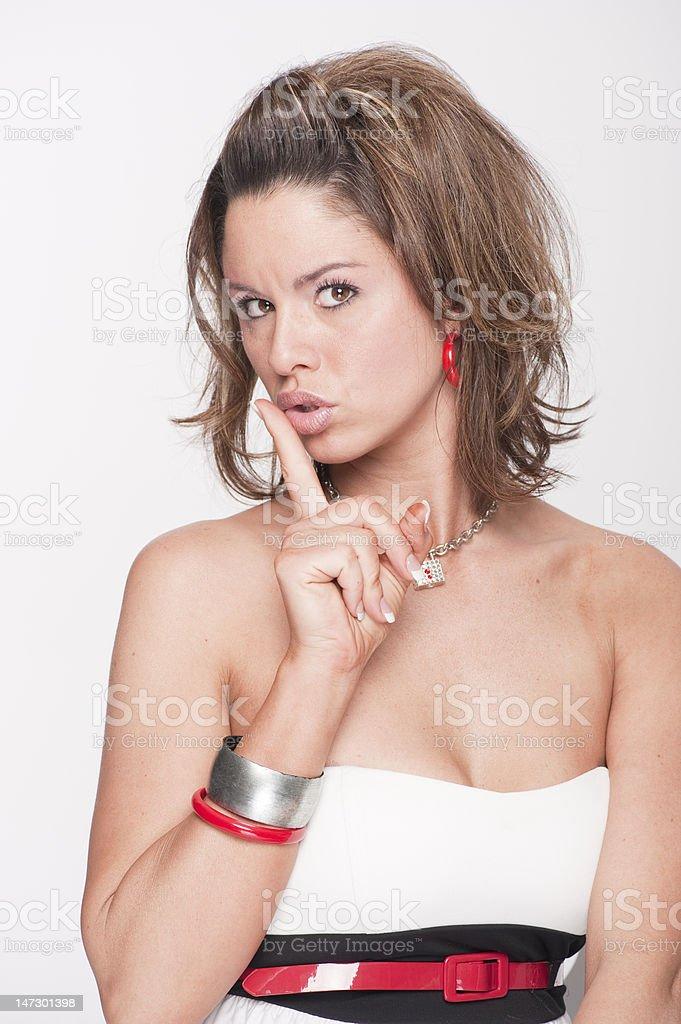 Beautiful girl saying 'shhhh' royalty-free stock photo