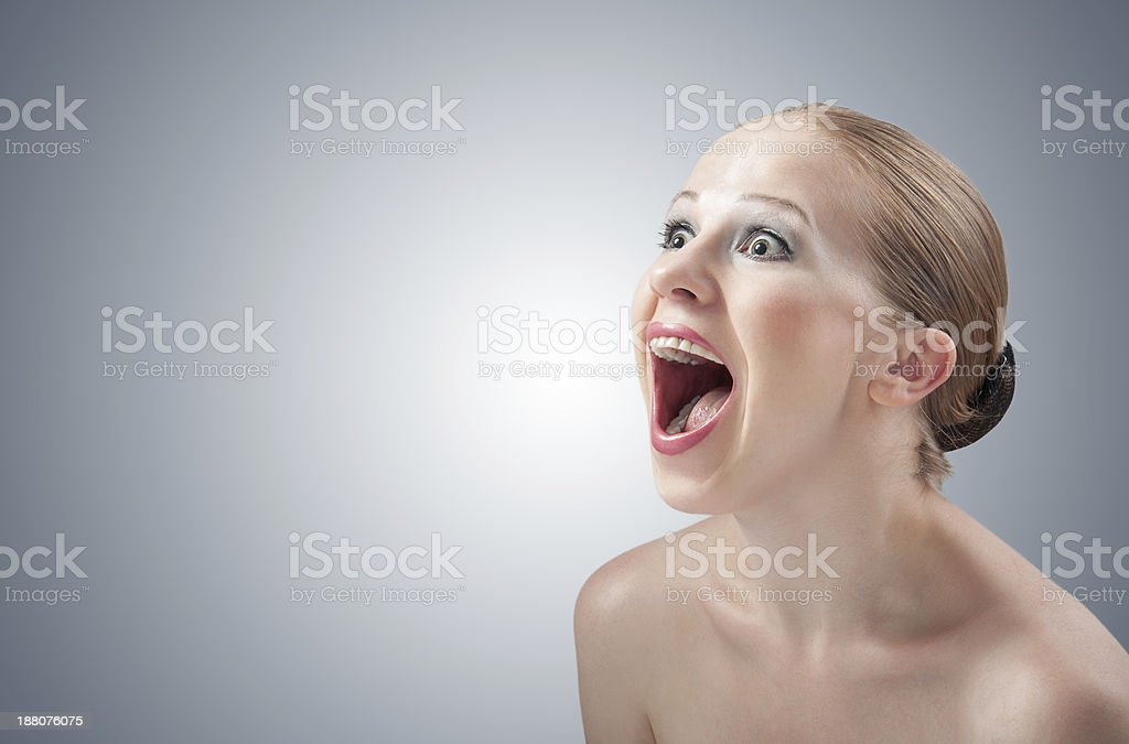 beautiful girl screaming angry aggressive.  throws emotions royalty-free stock photo