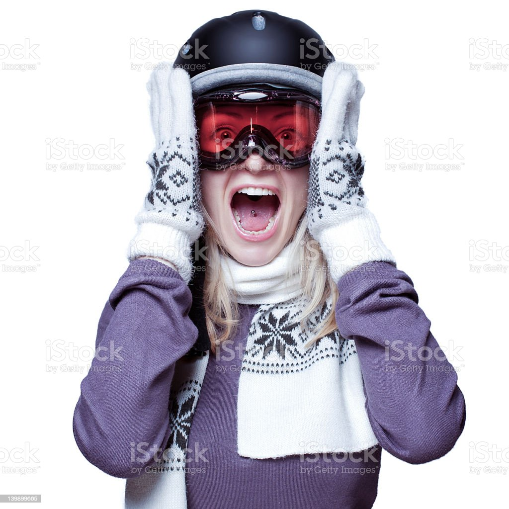 Beautiful girl screaming while wearing a helmet, scarf and gloves stock photo