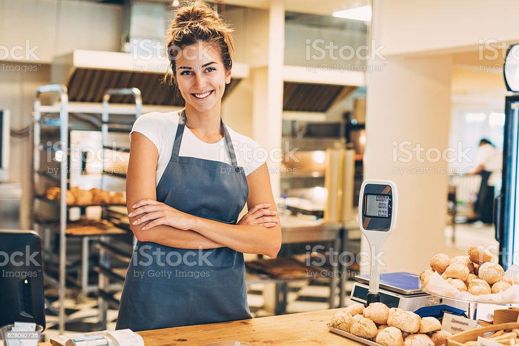 Beautiful girl selling pasrty stock photo