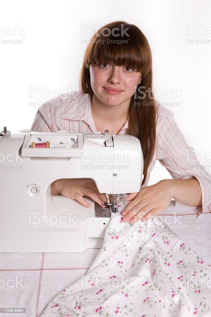 Beautiful girl sewing (vertical-2) royalty-free stock photo