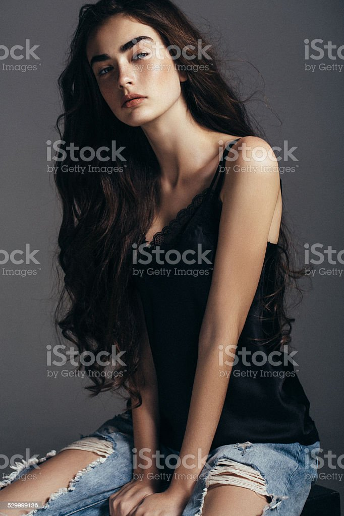 Beautiful girl sitting at the studio stock photo