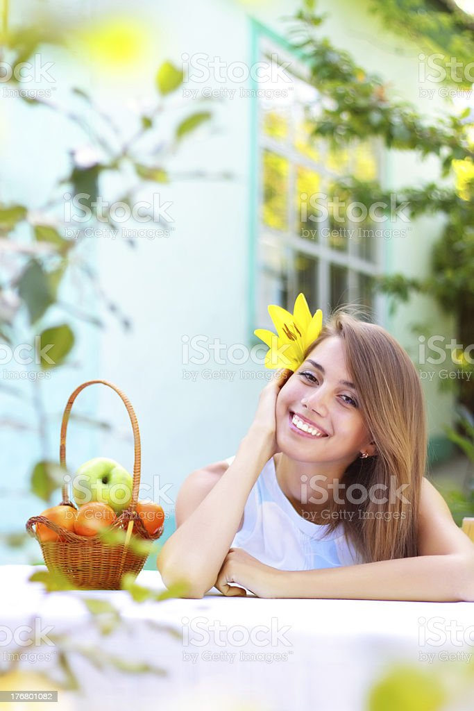 beautiful girl sitting at the table royalty-free stock photo