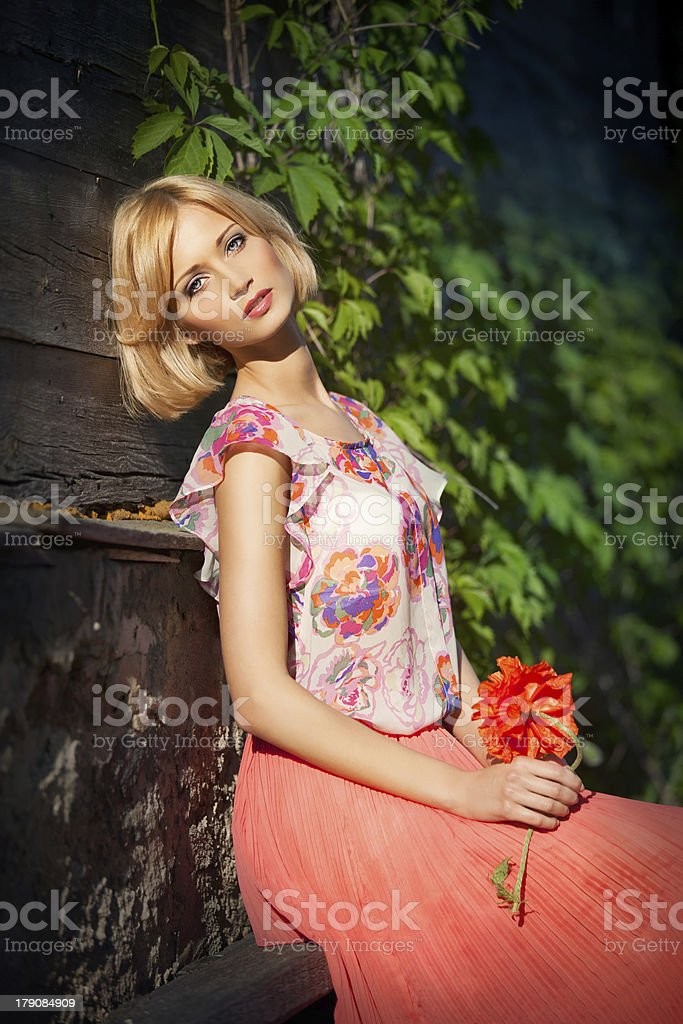Beautiful girl sitting on bench royalty-free stock photo