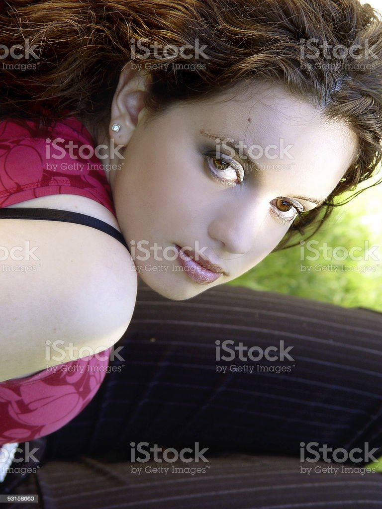 Beautiful girl sitting on the grass royalty-free stock photo