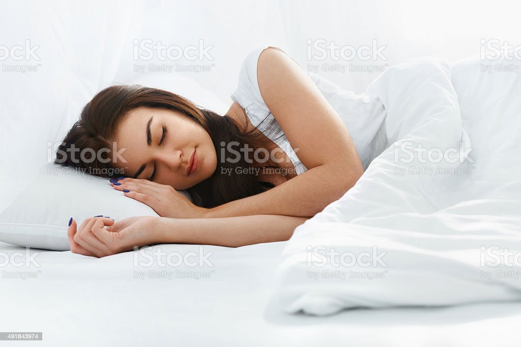 Beautiful girl sleeping in the bedroom stock photo