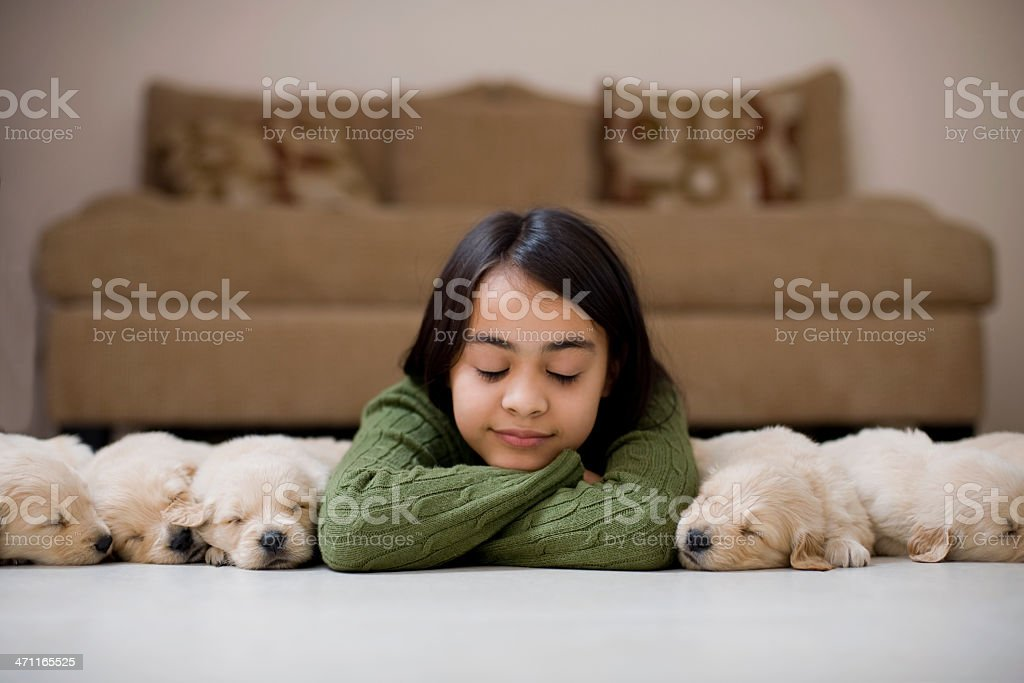Beautiful girl sleeping whit her dogs royalty-free stock photo