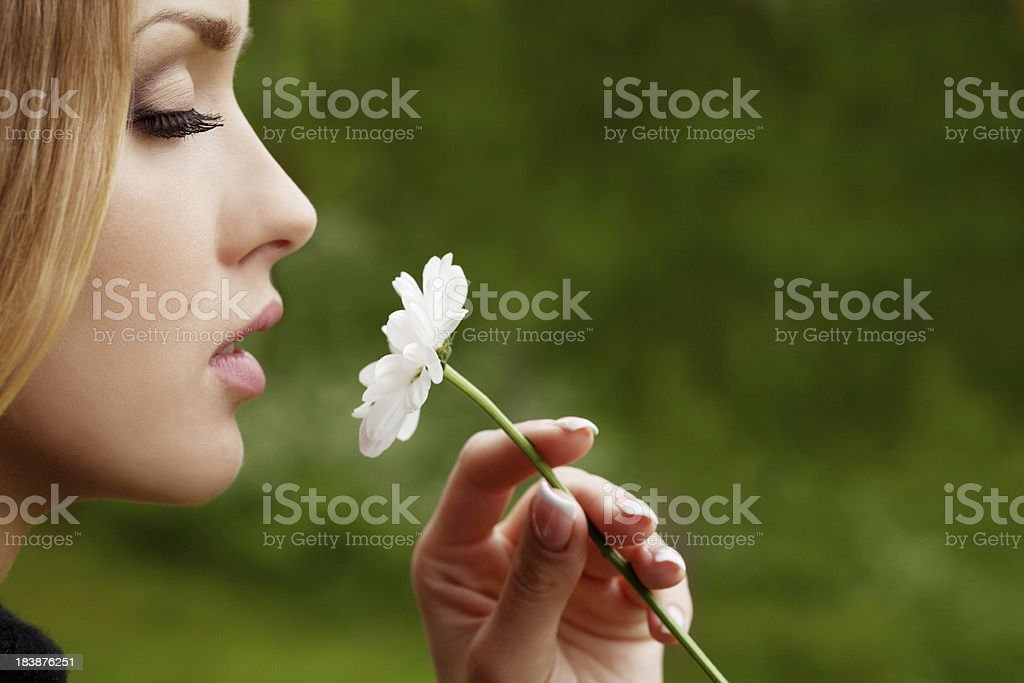 Beautiful girl smelling a flower royalty-free stock photo