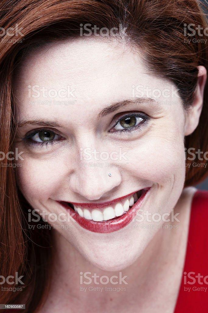 Beautiful girl smiling at camera face close up _ Vertical royalty-free stock photo