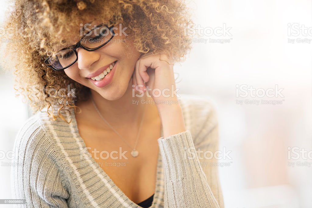 Beautiful girl smiling by the window stock photo