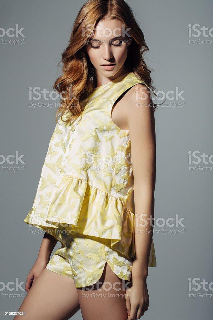 Beautiful girl standing at the studio stock photo