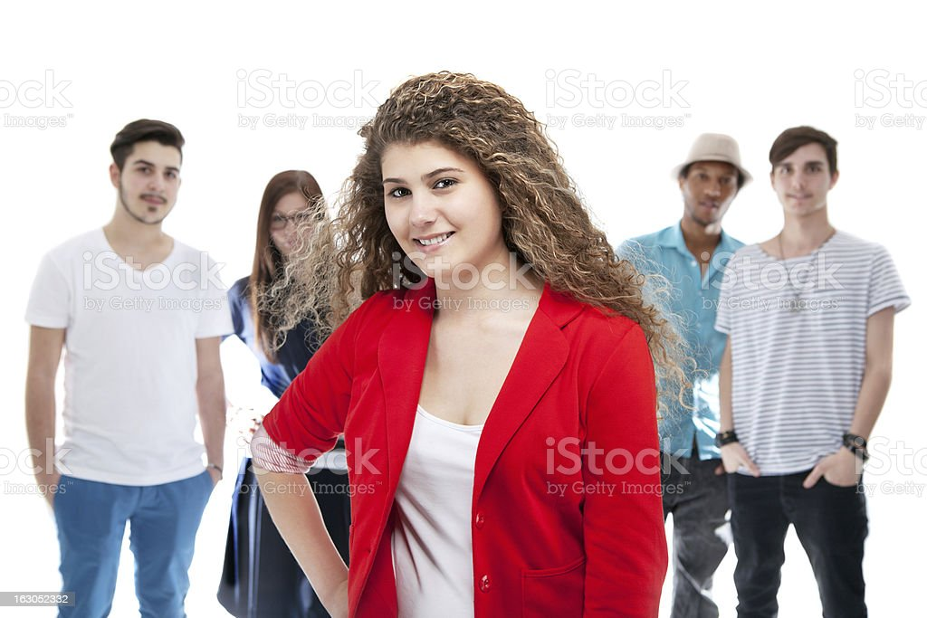 Beautiful Girl Standing In Front Of Her Friends royalty-free stock photo