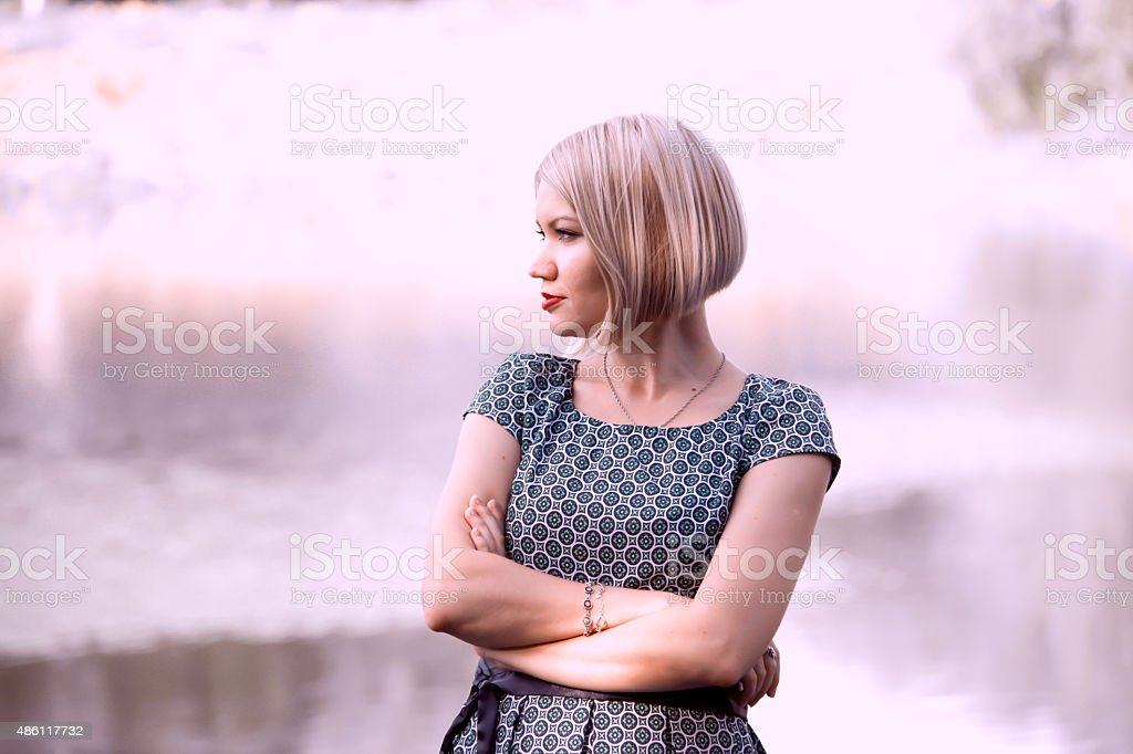 Beautiful girl standing in profile stock photo