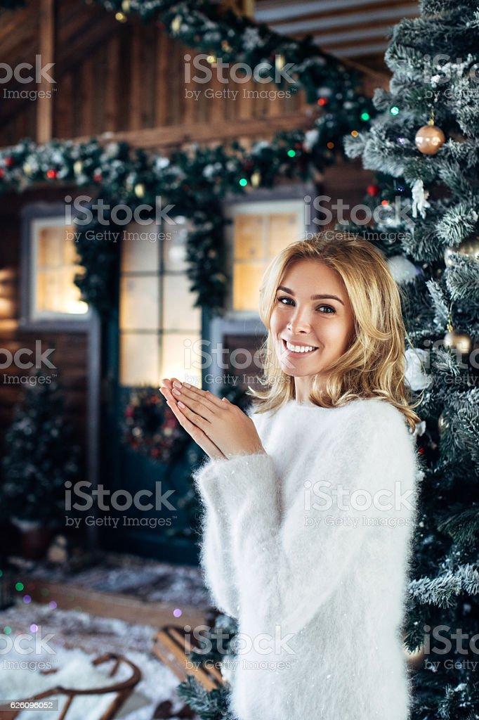 Beautiful girl standing near her house stock photo