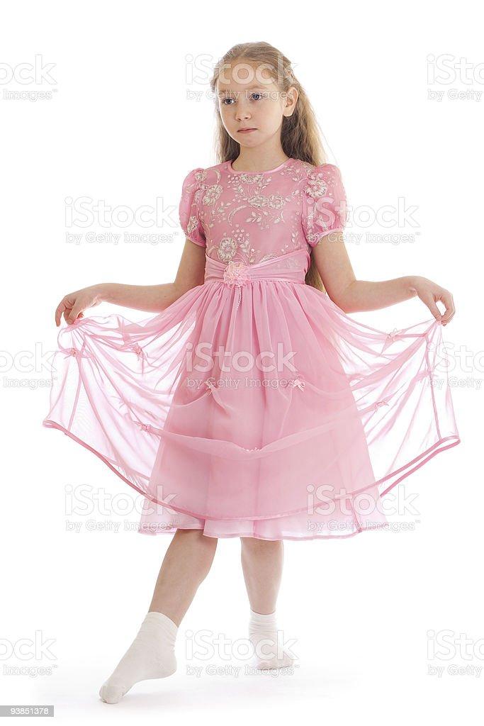 Beautiful girl standing on floor in ball dress stock photo
