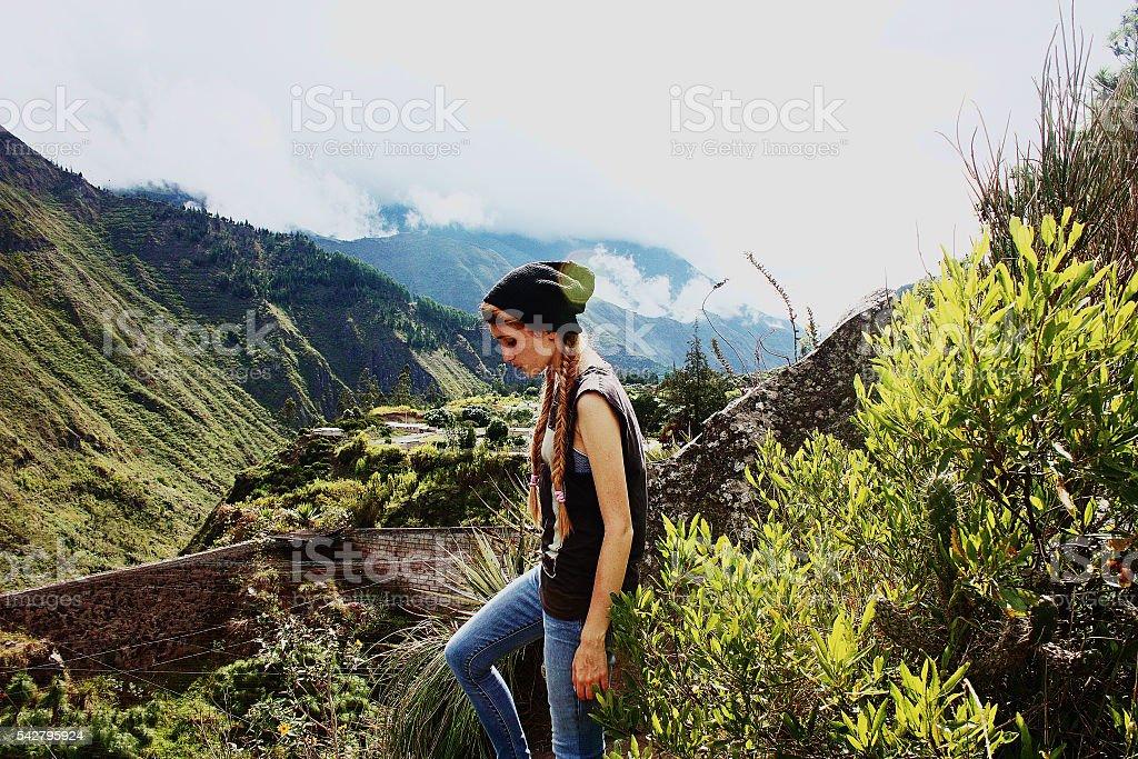 beautiful girl standing on mountain background, Ecuador stock photo