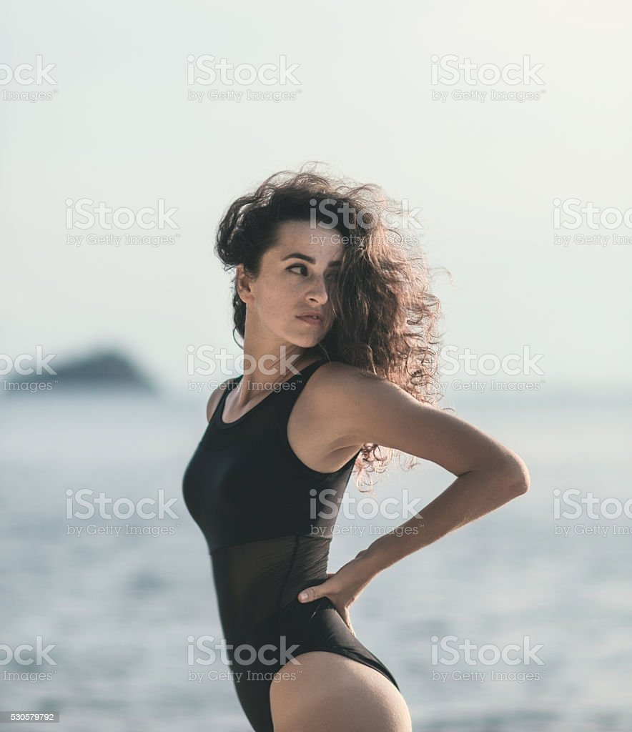 beautiful girl stands near the shore in summer stock photo
