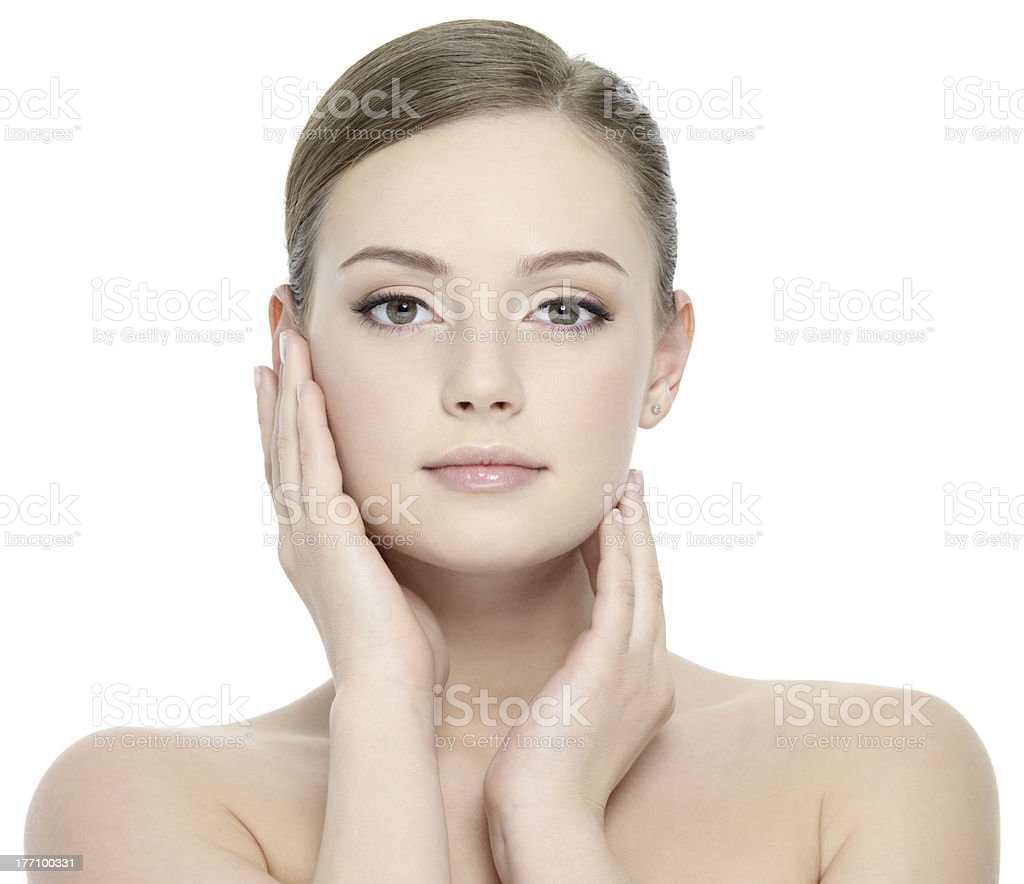 Beautiful girl stroking her face stock photo