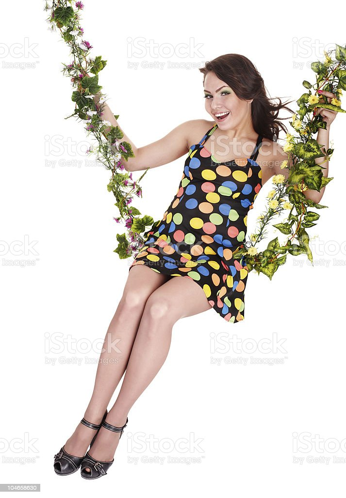 Beautiful girl swinging on flower swing royalty-free stock photo