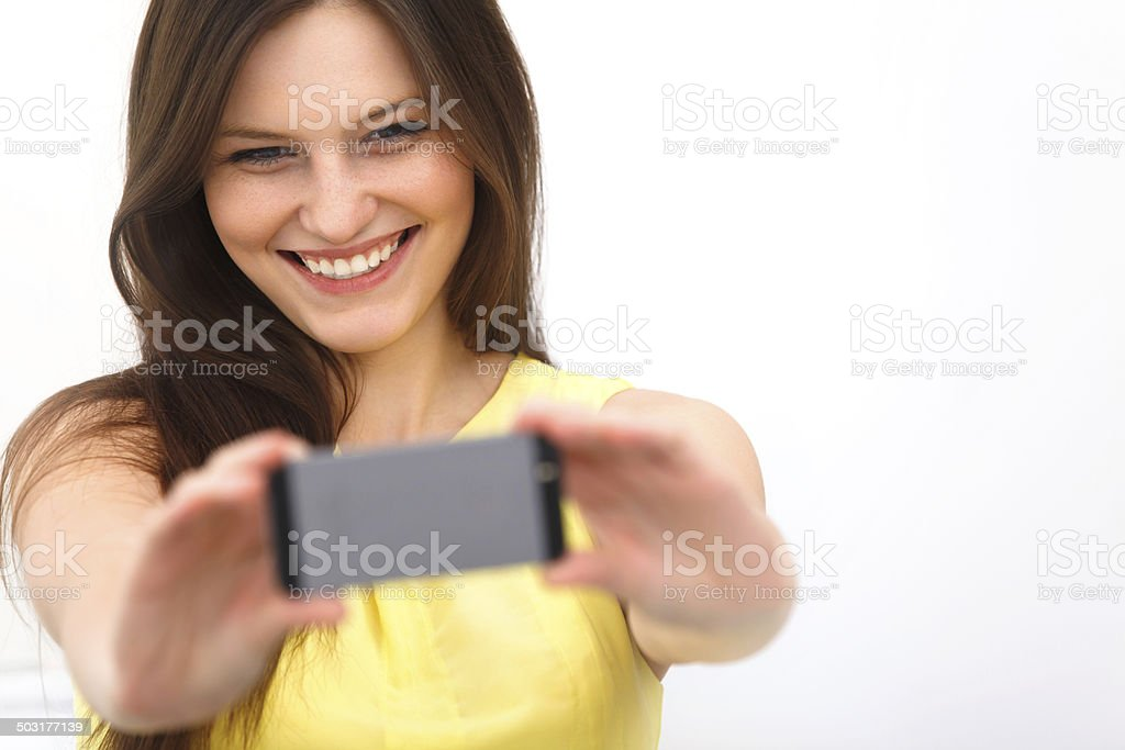 Beautiful girl taken taking selfie self-portrait with phone stock photo