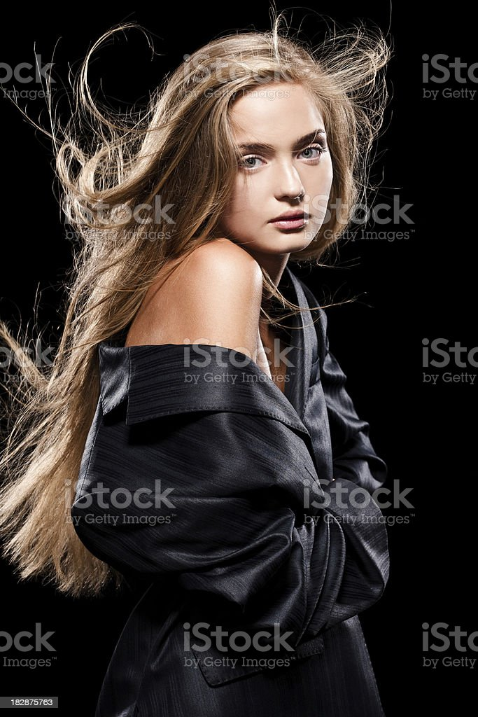 Beautiful girl taking a jacket off royalty-free stock photo