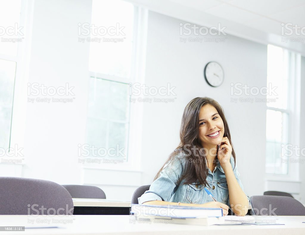 Beautiful girl taking notes in classroom royalty-free stock photo