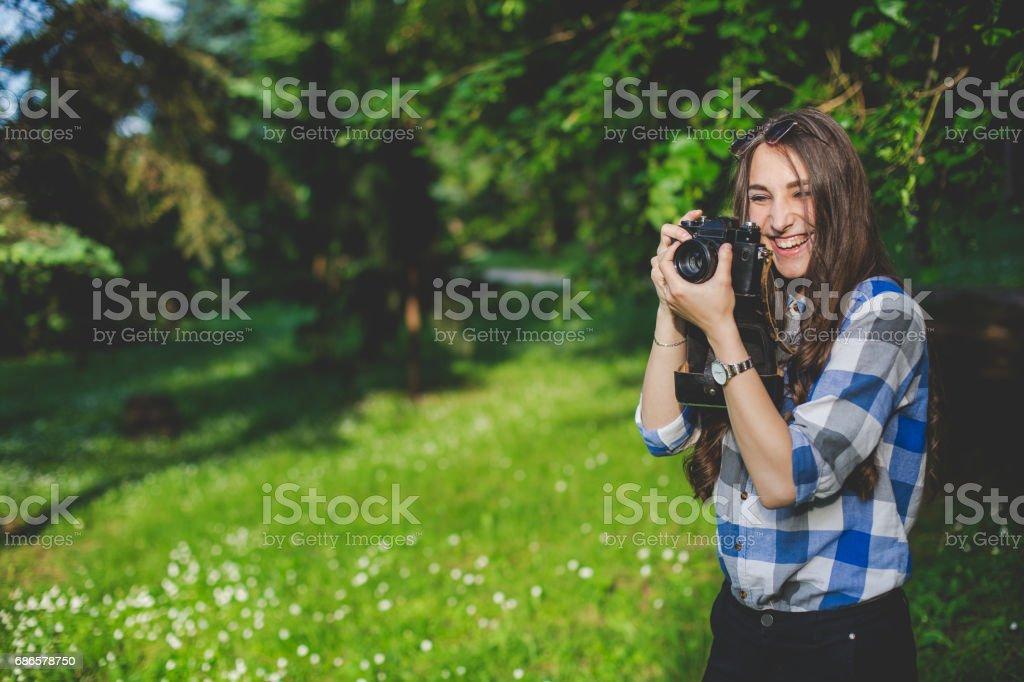 Beautiful girl taking photo. stock photo