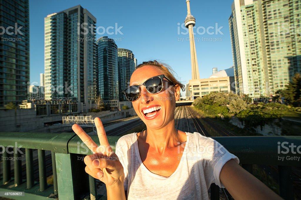 Beautiful girl taking selfie in Toronto-CN tower stock photo