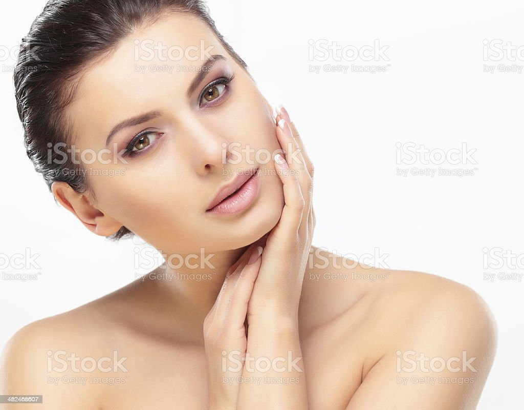 Beautiful Girl Touching Her Face stock photo