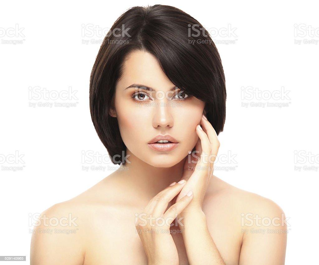 Beautiful Girl Touching Her Face stock photo