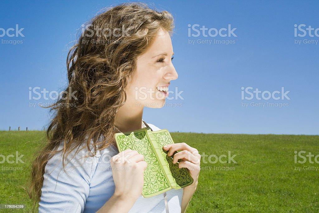 Beautiful Girl Treasuring Her Book royalty-free stock photo