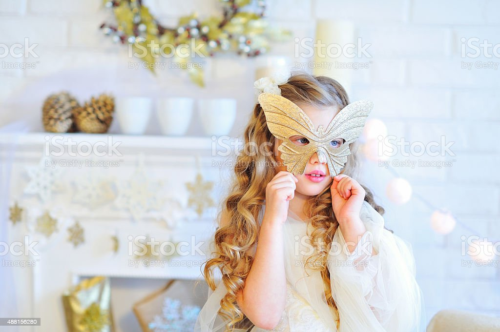 Beautiful girl trying on carnival mask stock photo