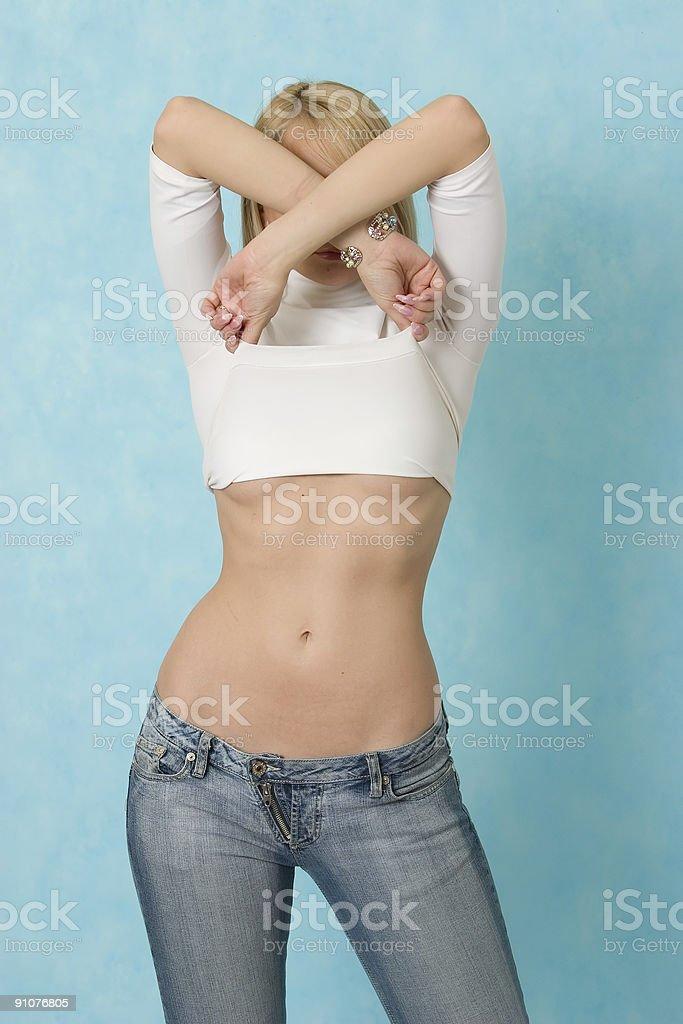 Beautiful girl undresses. royalty-free stock photo
