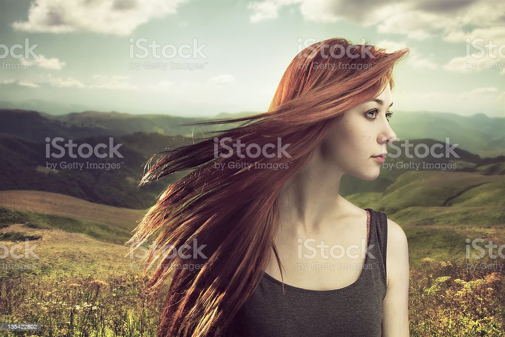 beautiful girl upland with hair blown by wind royalty-free stock photo