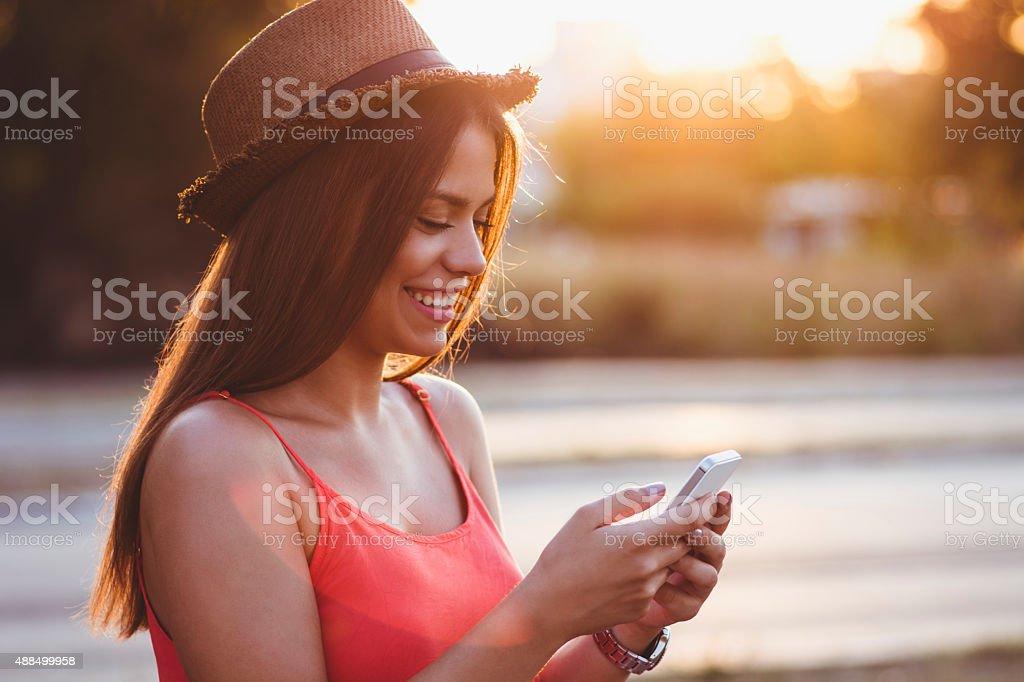 Beautiful girl using smartphone stock photo