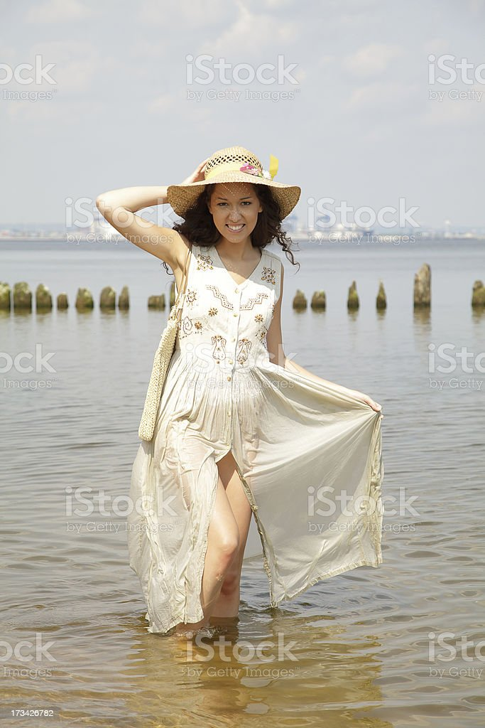 Beautiful girl walking on the beach royalty-free stock photo