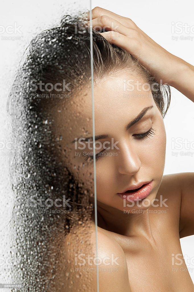 Beautiful girl washes her head stock photo