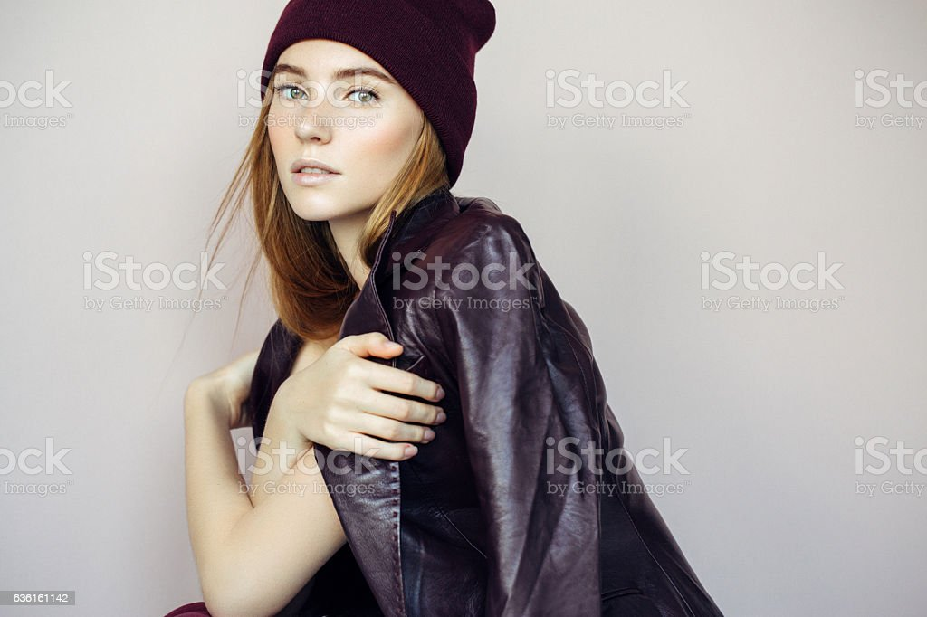 Beautiful girl wearing leather jacket stock photo