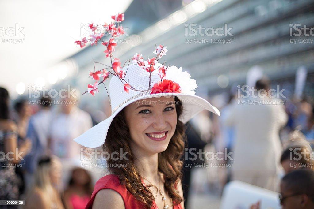 Beautiful Girl wearing Sakura Hat at Horse Race stock photo